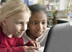 children looking at a laptop