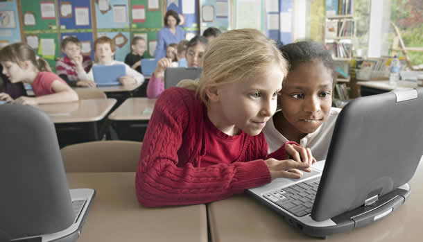 photo of children with a laptop