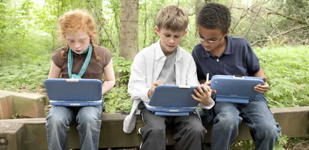 photo of children with laptops