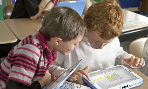 photo of children with a tablet