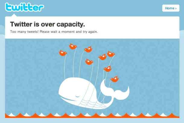 Error message: Twitter is over capacity. Too many tweets! Please wait a moment and try again. Image shows a whale being lifted out of the waves by small birds.