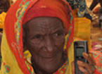 Woman in traditional dress holding a mobile phone