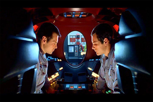 Two astronauts talking, with their mouths visible.