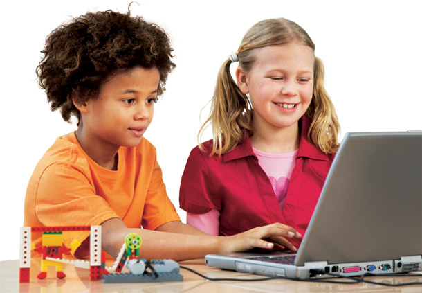 Two children working at a computer together