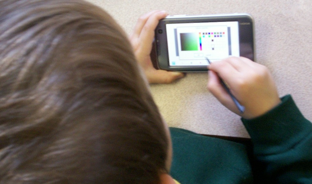 child using a smartphone with a stylus