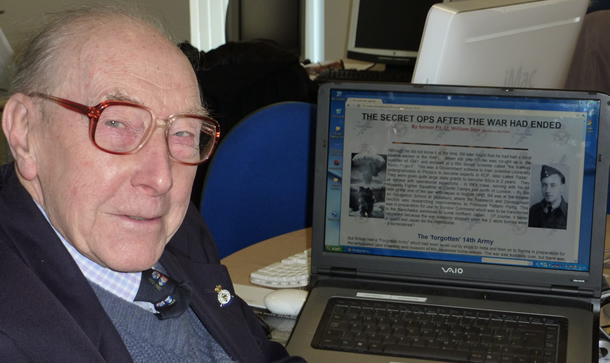 Photo of an older man with a website