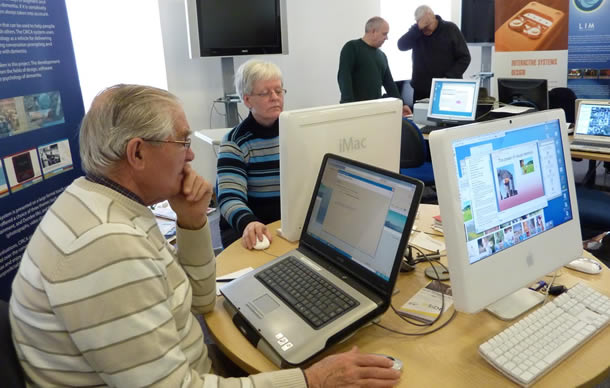 Photo of older adults using computers