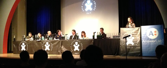 Judges at a table on stage