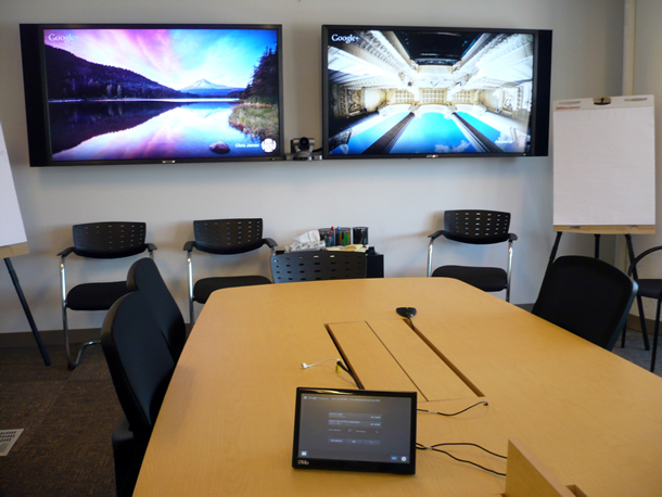 A room with a two-screen teleconferencing system