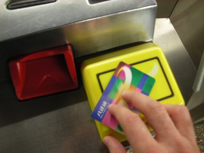 photo of person scanning a transit card