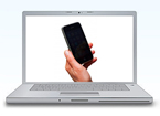 Laptop with cell phone on screen
