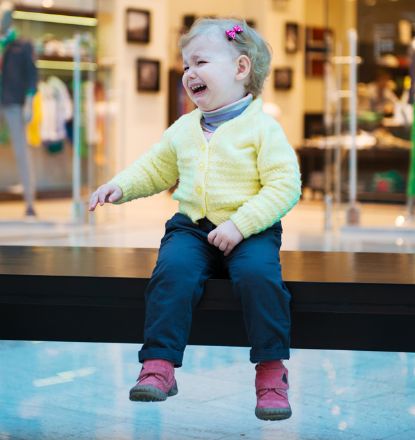 A crying child in a store.