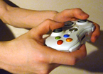 Hands holding game controller