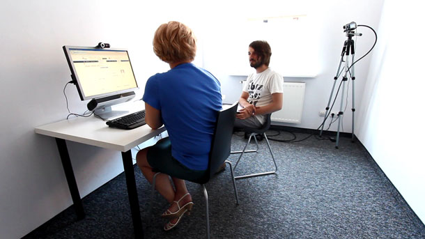 Photo of a participant and a moderator sitting at a computer.