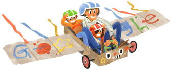 Father, son and daughter riding in a home-made winged go-cart