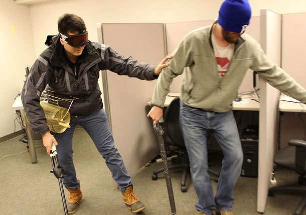 Project team members wearing blindfolds to simulate visual impairment that first responders face.