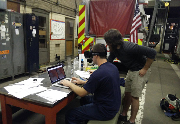 Image testing a heads-up display with firefighters.
