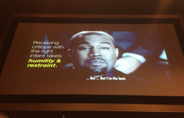 """A slide from Adam Connor's session on Discussing Design that says, """"Receiving critique with the right intent takes humility and restraint."""" A photo of musician Kanye West is displayed in the background. West is saying """"…But…But I'm the best."""""""