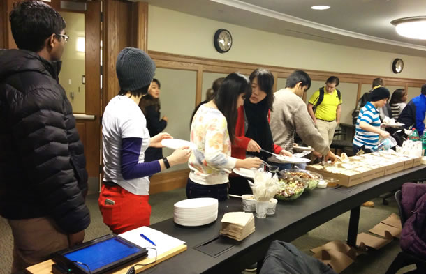 Students line up at a food buffet.