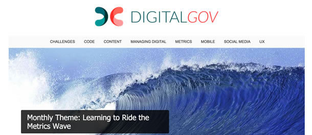 Screen shot with an image of a large wave. The monthly theme shown is Learning to Ride the Metrics Wave.