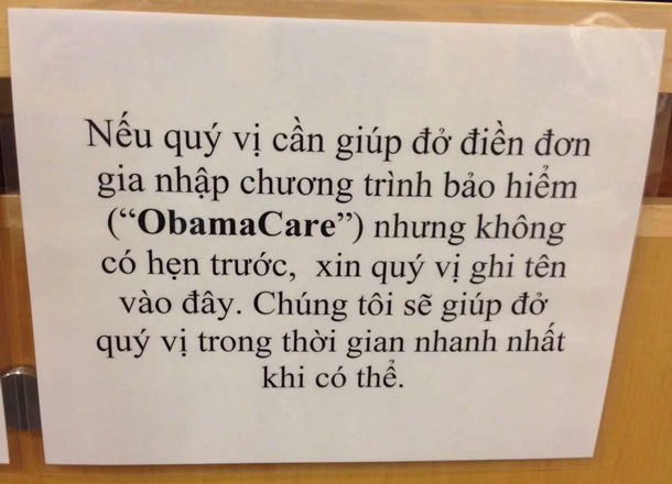 """A picture of a sign in a health clinic in Vietnamese with the word """"Obamacare"""" in English."""