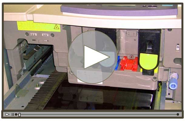 Opening screen of a printer repair video showing the inside of the device