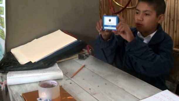 Photo of a student working with a prototype portable learning device