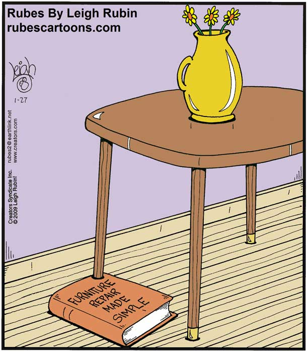 A book titled furniture repair made simple is placed under a table leg, making the table stand level.