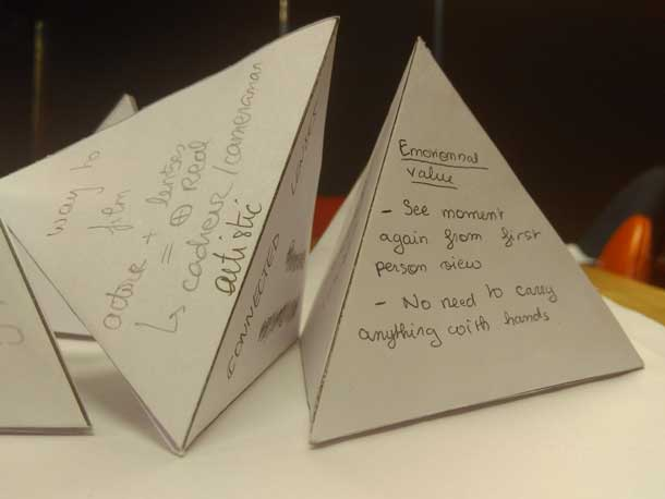 Paper pyramids. the visible one says Emotional Value. See moment again from first person view. No need to carry anything with hands.