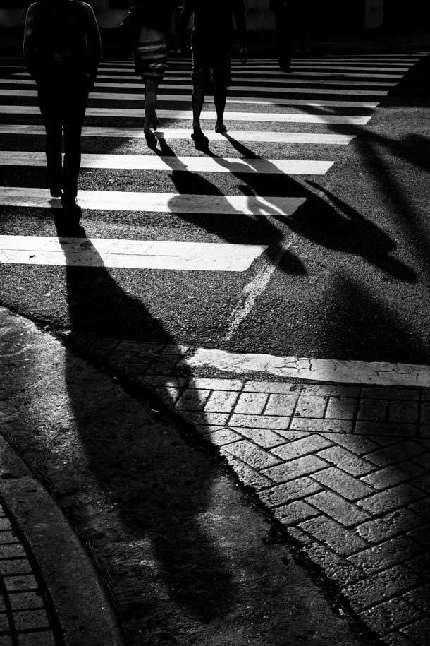 Los Angeles street scene filled with shadowy figures