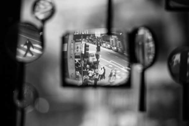 Street scene as viewed through a wall of magnifying glasses