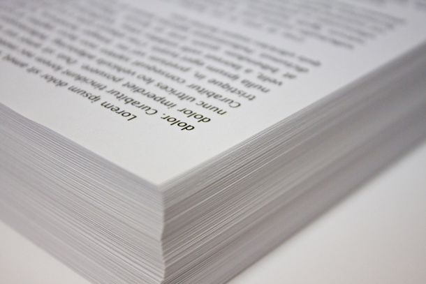 A stack of paper with typing on it
