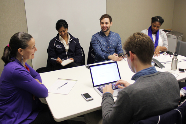 Photograph of a group interviewing a participant