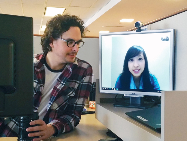 Two designers connect over screen sharing software.