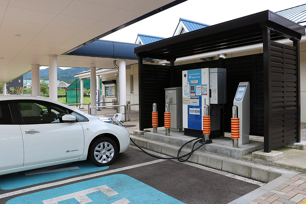 Photograph of a car being charged at an electric car charging station.